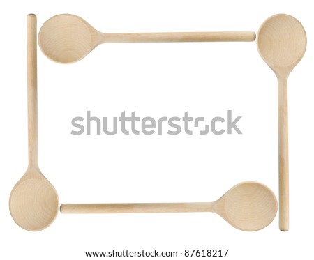 Wooden spoons frame isolated on white background - stock photo
