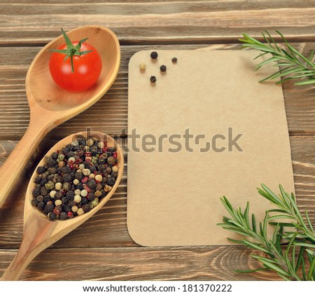 Wooden spoons on a brown background