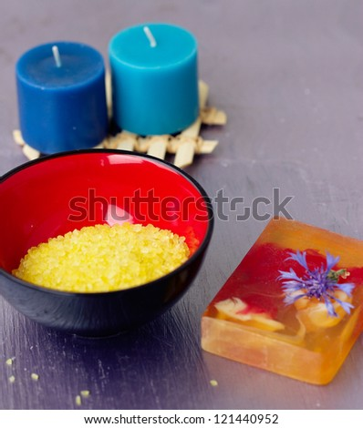 Wooden spoons with herbal and sea salt - stock photo