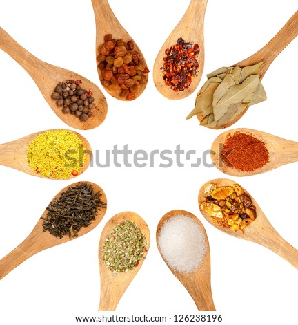 wooden spoons with seasonings on a white background, each one is shot separately - stock photo