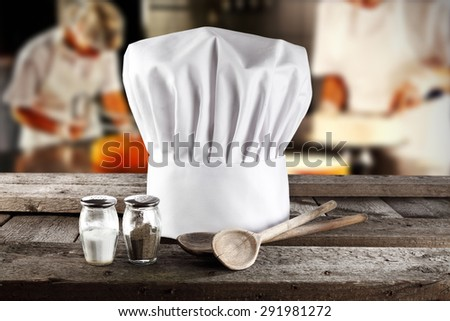wooden spoons wooden top and cook hat