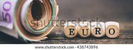 wooden squares with the inscription euro, money role