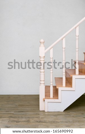 wooden stair to second floor with laminate wood like floor - stock photo