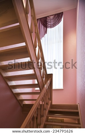 Wooden Staircase, ladder in the modern luxury house. Vertical.
