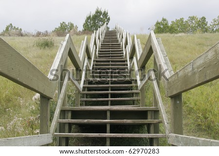 Wooden staircase on the hillside - stock photo