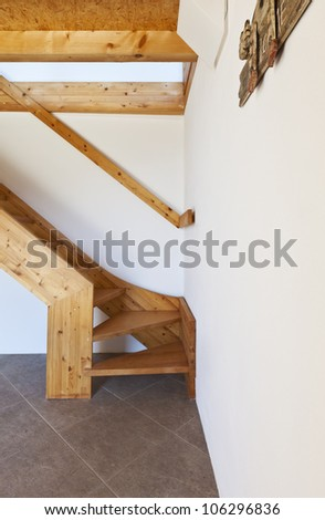 wooden staircase, rural home interior - stock photo