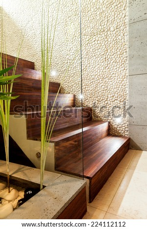Wooden stairs in luxury and modern apartment - stock photo
