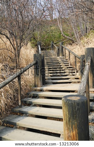 Wooden Stairway leading uphill, in Hokkaido Japan. - stock photo