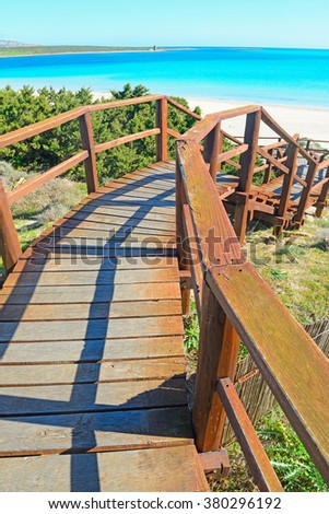 wooden stairway to the beach in Sardinia, Italy - stock photo