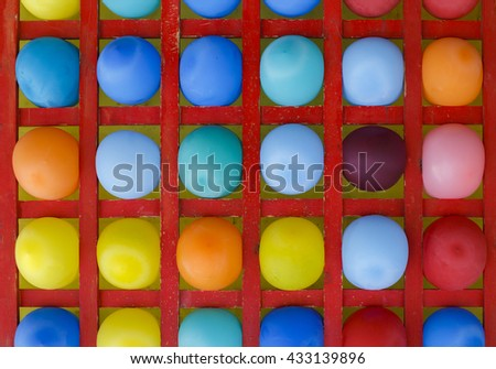 wooden stand with multicolored balloons. amusement throwing darts at balloons. colorful background - stock photo