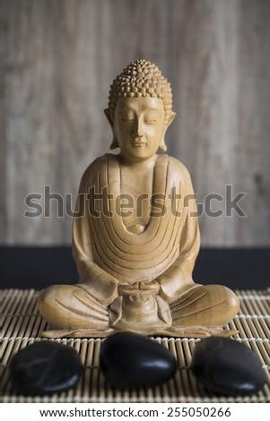Wooden Statue of Buddha - stock photo