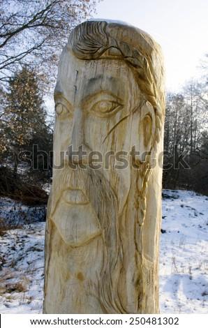 Wooden statue of the Slavic idol.  Ukraine.  - stock photo