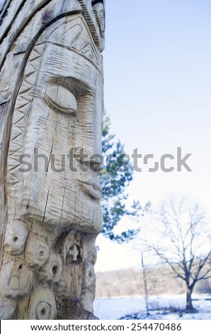 Wooden statue of the Slavic idol.  Ukraine.  - stock photo