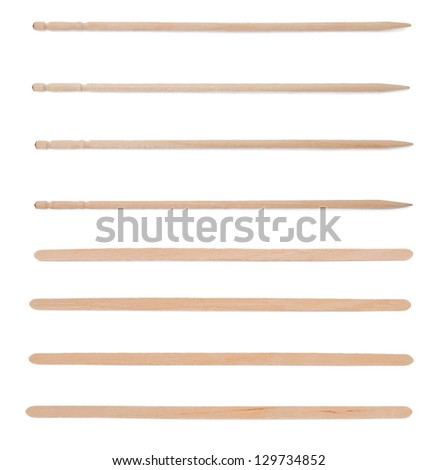 Wooden stick stirrers and canape sticks on white - stock photo