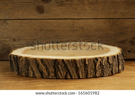 wooden stump in the old wooden background - stock photo