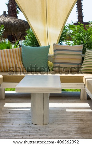 Wooden sun chair on outdoor deck cafe overlooking the Mediterranean Sea