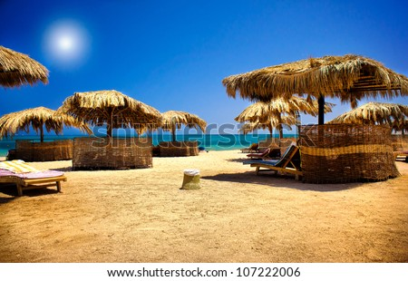Wooden sunbeds  on the beach. - stock photo