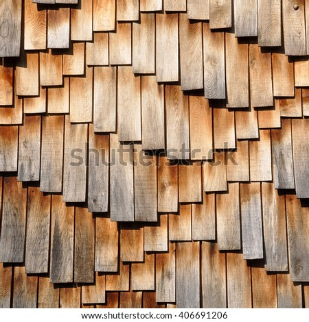 Wooden surface in abstract wavy brown background - vintage effect style wooden design. Wooden shingles are composed of many individual elements, planks, small boards. Waved natural pattern