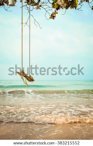 Wooden swing on  tropical beach  - stock photo