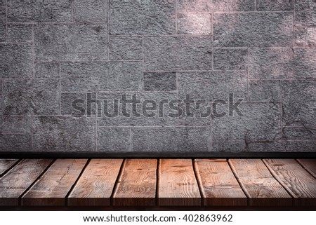 Wooden table against grey
