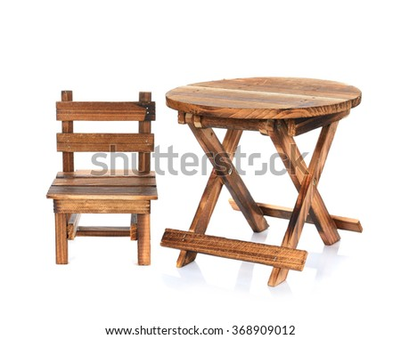 Wooden table and chair isolated on white background