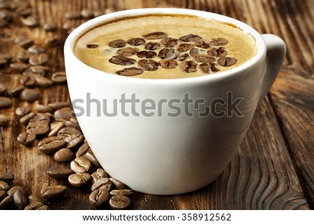 wooden table and coffee and cup  - stock photo