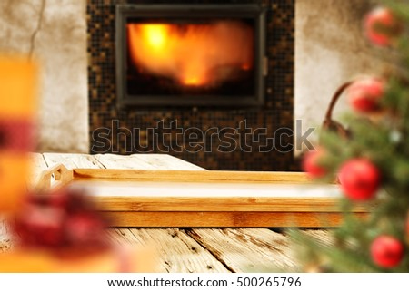 wooden table fireplace and xmas tree