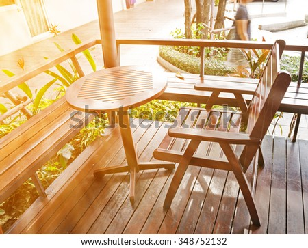 Wooden Table in Coffee Shop With Sunlight Warming Tone