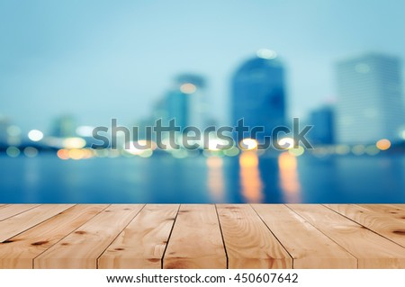 Wooden table in front of  blurred landscape