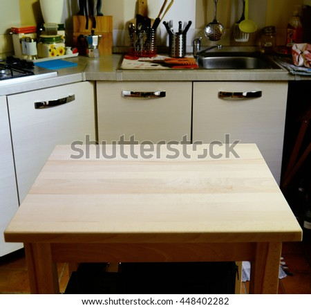 Wooden table on blurred background of kitchen