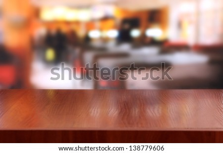 Wooden table on cafe background - stock photo