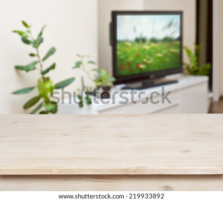 Wooden table on lounge room interior background - stock photo