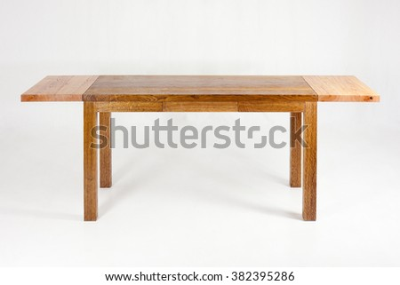 wooden table - piece of furniture in front of white blackground - stock photo