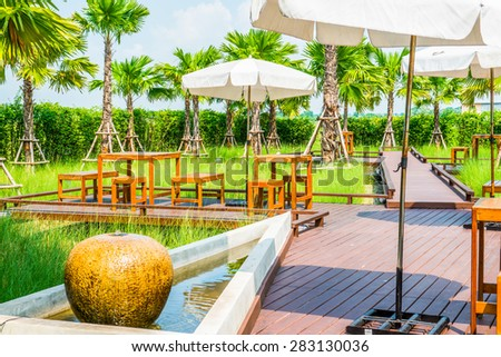 Wooden Table Set in the Park, Thailand. - stock photo
