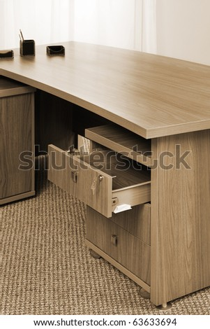 wooden table with an open box in the office - stock photo