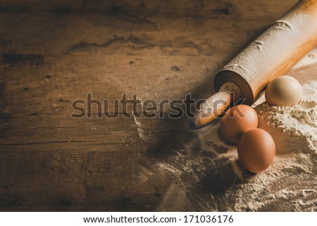 Wooden table with baking equipment - stock photo