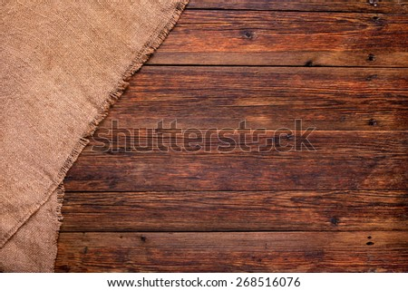 wooden table with burlap texture background with copy space - stock photo