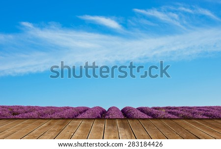 Wooden table with lavender fields. - stock photo