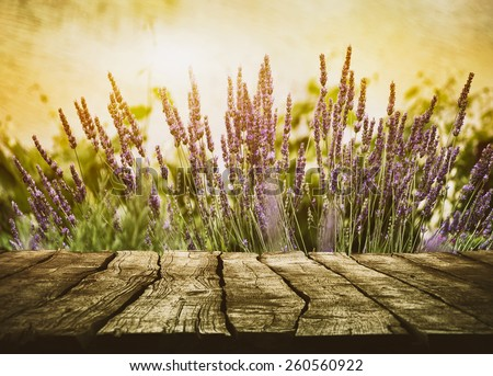 Wooden table with lavender. Wood tabletop with flowers - stock photo