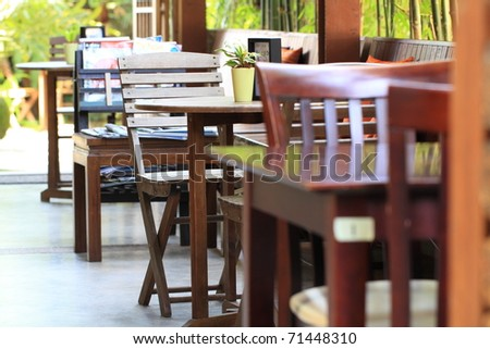 Wooden tables and chairs - stock photo