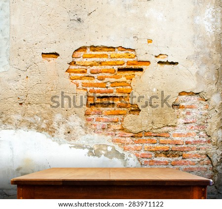 wooden tabletop at crack concrete wall,Template mock up for display of product,Business presentation. - stock photo