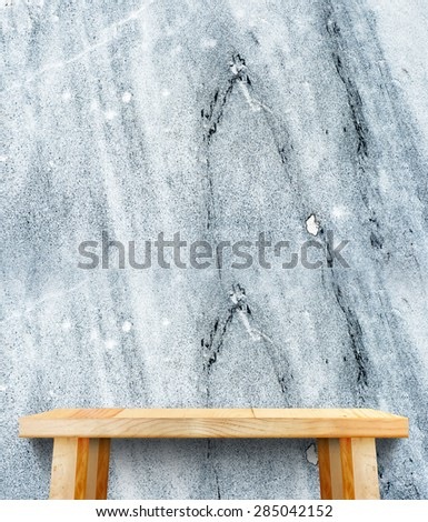 wooden tabletop at stone wall,Template mock up for display of product,Business presentation. - stock photo