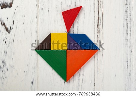 wooden tangram in an apple shape