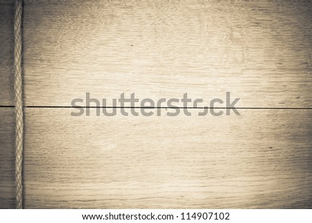 Wooden texture background with rope - stock photo