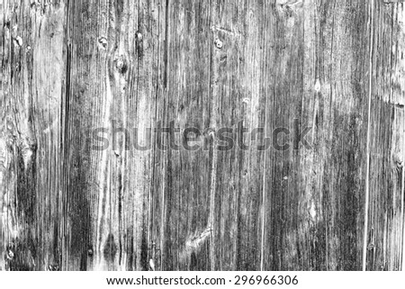Wooden texture of black and white color with scratches and cracks, which can be used as a background