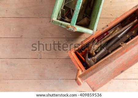 Wooden toolbox with tools on wood balckground