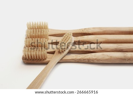 Wooden toothbrushes on white background - stock photo