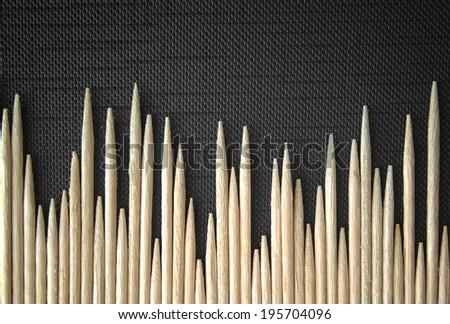 wooden toothpicks / toothpicks photo on black background texture - stock photo
