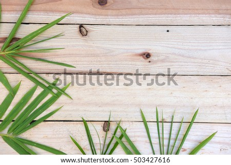wooden top and bamboo leaves background