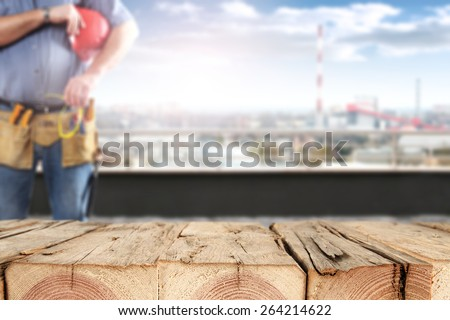 wooden top and worker  - stock photo